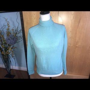 A wool turtleneck sweater